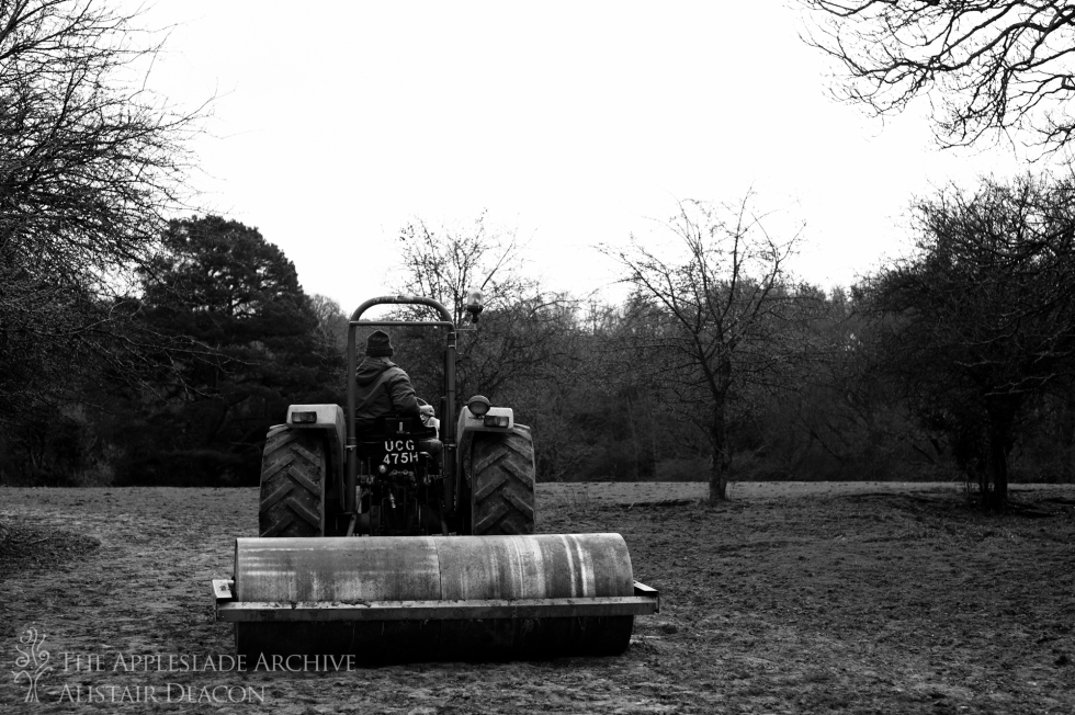 Richard Deacon rolling poached land so the grass can grow, Red Shoot Lawn, New Forest, Hampshire, 27th April 2013