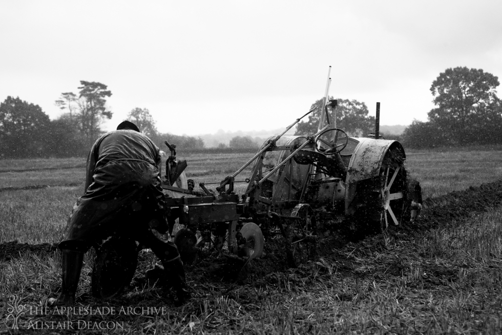 A competitor adjusts his plough in the rain, SCHHA Ploughing Match, Charford Manor Farm, Nr. Breamore, Hampshire, 20th Oct 2013
