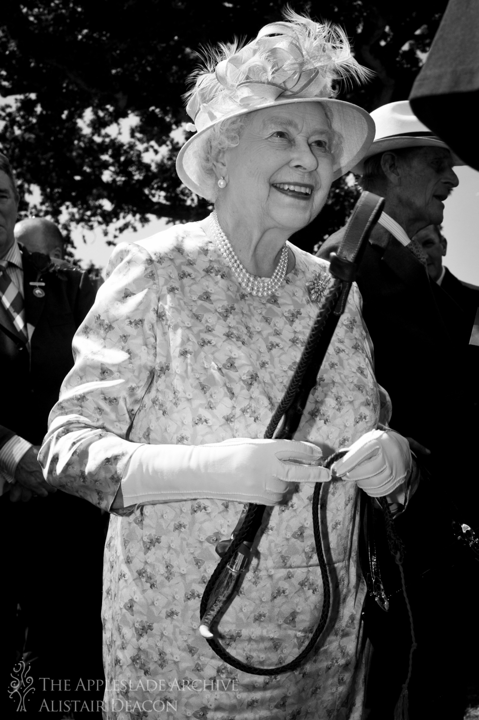 Queen Elizabeth II of England recieves a commemorative hunting whip from the Commoners of the New Forest in celebration of her 60th year on the throne, New Forest Show, New Forest, Hampshire, 25th July 2012