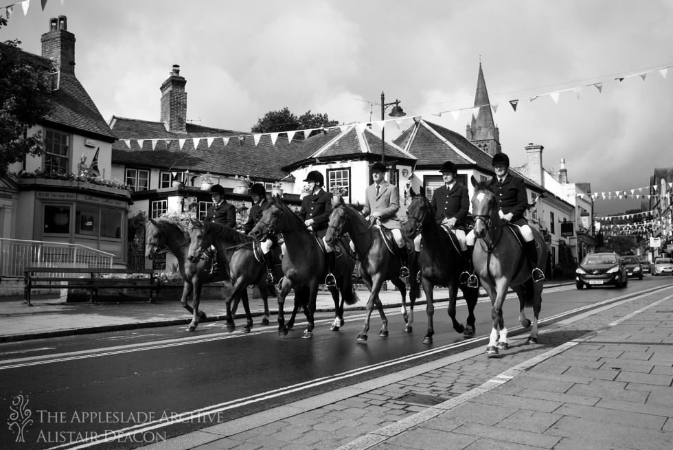 The New Forest Agisters and Head Verderer riding down Lyndhurst High Street to celebrate Queen Elizabeth's Diamond Jubilee, Lyndhurst, New Forest, Hampshire, 4th Aug 2012