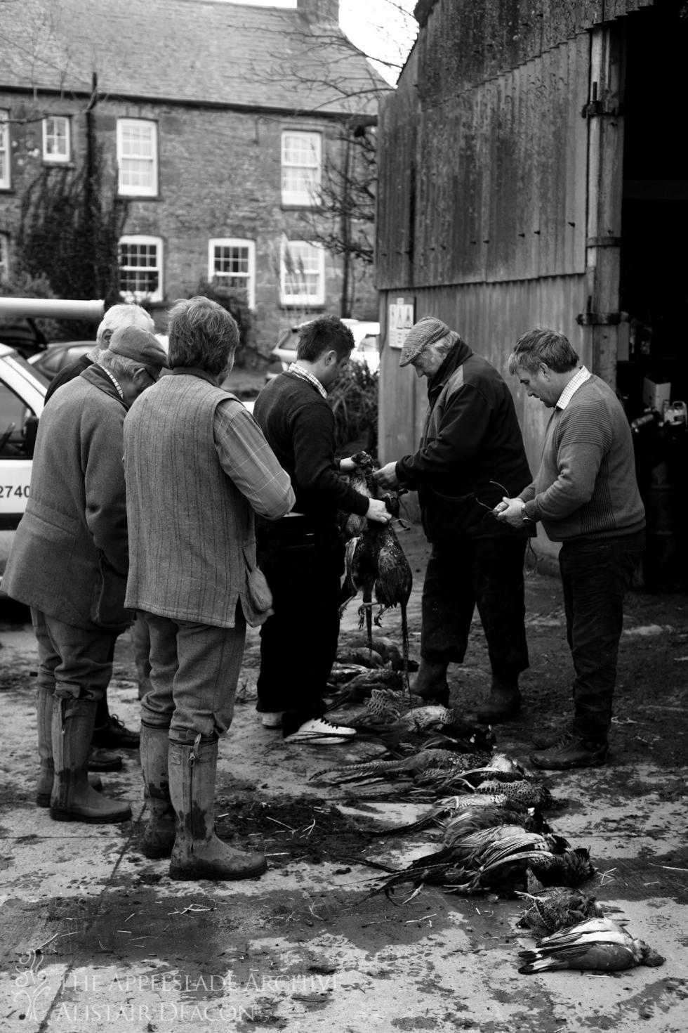 Dividing up the pot, Ennis Barton, St. Enoder, Cornwall, January 2014
